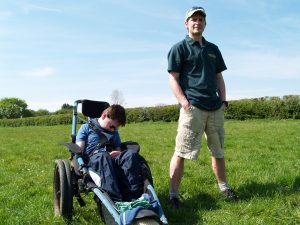 Sam (with dad) in his all terrain wheelchair